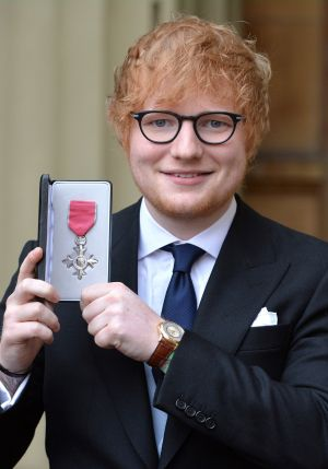 HONOURED: Singer Ed Sheeran poses with his MBE medal that was presented to him by the Prince of Wales during an Investiture ceremony at Buckingham Palace, London. Photograph: John Stillwell - WPA Pool/Getty Images