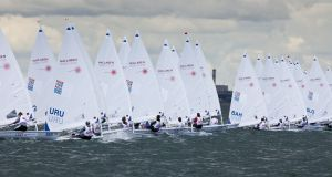 The Laser Radial boys' fleet in the  Youth World Sailing Championships  on Dublin Bay in 2012. Conor Quinn will compete  in the boys' Radial class in China.  Photograph: David Branigan/ISAF