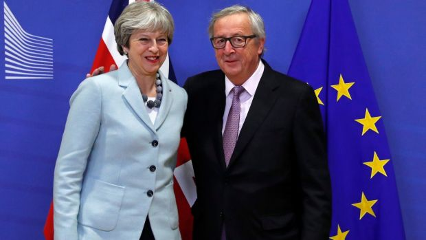 Britain's prime minister Theresa May and European Commission president Jean-Claude Juncker in Brussels on Friday morning. Photograph: Reuters