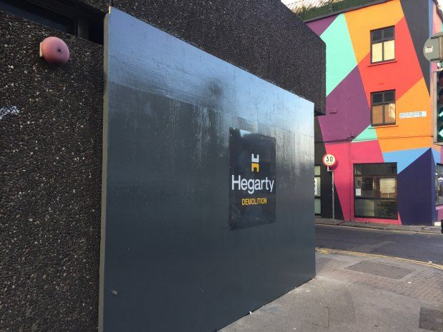 Hoarding was erected at Apollo House in early December by Hegarty Demolition. Photograph: Paddy Logue