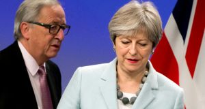 British prime minister Theresa May and European Commission president Jean-Claude Juncker address a media conference at EU headquarters in Brussels on Friday morning. Photograph: AP