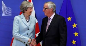 Britain's prime minister Theresa May is welcomed by European Commission president Jean-Claude Juncker at the European Commission headquarters in Brussels. Photograph: Yves Herman/Reuters