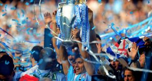 Sergio Aguero of Manchester City celebrates with the Premier League trophy in 2012. Photograph:  Shaun Botterill/Getty Images