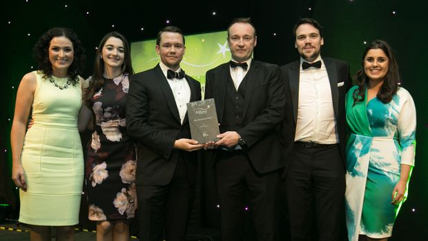 Ross Mc Donnell, Sponsorship Manager, Media Central presents the Best Sponsorship Brand award to the AIG Insurance Marketing team.