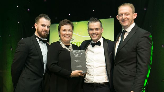 Neil MacDermott – Head of Solutions, Media Central, presents the Best Multi-Platform Sponsorship award to Paddy Carberry, Paula Murphy and Gerry Nixon, Vodafone.