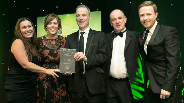 Tony O'Flanagan, Marketing Director, JCDecaux, presents the Best Use of Print & Outdoor award to  Aldi team.
