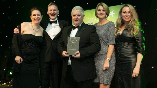 Jim O'Toole, Principal, sportsinterim.com, presents the Best Low Budget Sponsorship award to the Post TV & TG4 team.