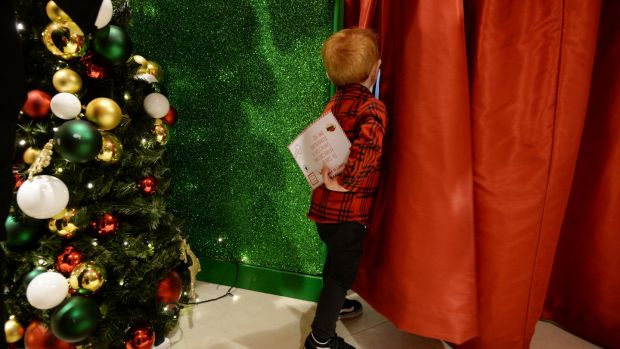 Leo O'Keeffe (two and a half) from Tallaght is about to deliver his Santa letter at Arnotts. Photograph: Alan Betson