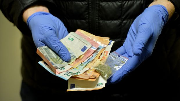 Gardaí display cash and drugs seized after a search of a Dublin rickshaw driver. Photograph: Alan Betson