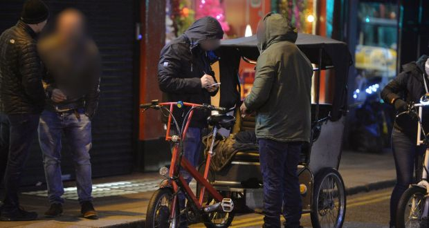 Undercover gardaí search a rickshaw driver on Dublin's Suffolk Street after observing a drug deal.  Photograph: Alan Betson
