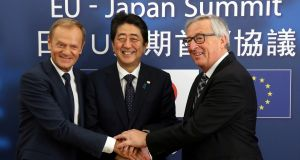 Japan's Prime Minister Shinzo Abe (C) at a meeting earlier this year wit h European Council President Donald Tusk (L) and European Commission President Jean-Claude Juncker