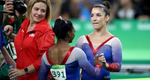 Aly  Raisman (R) of the United States is congratulated by Simone Biles (L) after competing on the Women's Floor final  at the  2016 Olympic Games in Rio. Photograph:  Julian Finney/Getty Images