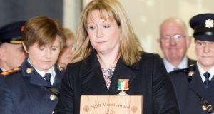 Nicola Golden with the Gold Scott Medal she collected on behalf of her late husband Garda Anthony Golden, who was murdered in Omeath. Photograph Liam Burke/Press 22
