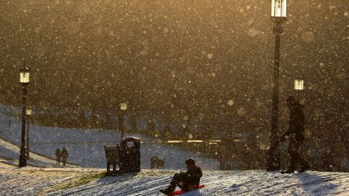 People go sledding on the grounds of Stormont Estate in Belfast, as snow hit parts of Ireland on Friday. Photograph: Brian Lawless/PA Wire