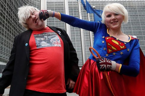 "BREXIT PROTEST: British anti-Brexit activists Madeleina Kay, nicknamed ""EU Supergirl"", and Drew Galdron, an impersonator of British foreign secretary secretary Boris Johnson, performing outside the European Commission HQ in Brussels, Belgium. Photograph: Yves Herman/Reuters"