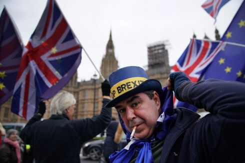 IMPACT ON ECONOMY: European Union and Union Jack flags are waved by protesters outside the Houses of Parliament in London, England. Brexit secretary David Davis told MPs the British government had not carried out any impact assessments on the UK economy  of leaving the EU. Photograph: Christopher Furlong/Getty Images