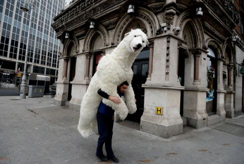 BEAR NECESSITY: Danny Balan carries a giant polar bear to the National Wax Museum Plus on Westmoreland Street in Dublin. Photograph: Cyril Byrne/The Irish Times
