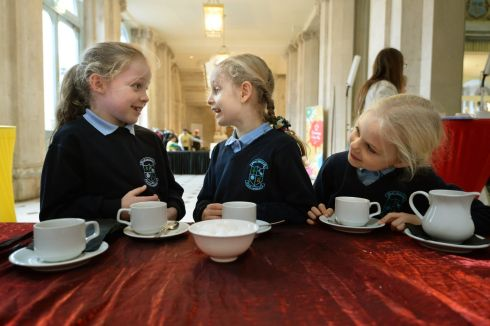 SOMEONE LIKE ME: Shannon Doherty (8), Rachel Mc Phillips (7) and Hannah Mc Phillips (6), from Killeevan National School in Co Monaghan, as primary schools gathered in Dublin City Hall where the winners of the Someone Like Me national art competition were announced. Photograph: Dara Mac Dónaill/The Irish Times