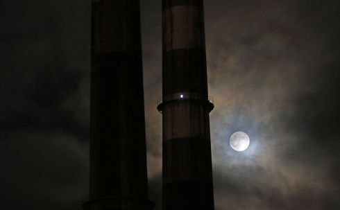 "DUBLIN VIEW: A ""Super Moon"" photographed late in the evening with Dublin's Poolbeg chimneys in view.  Picture Nick Bradshaw"