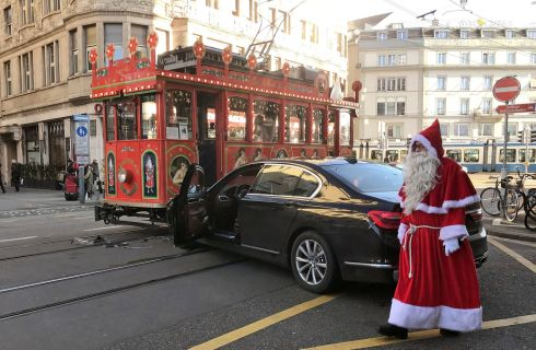 CHRISTMAS CRACKER: The driver of a Maerlitram (fairy tram) dressed as a Santa Claus, walks past a car which crashed into the tram in Zurich, Switzerland. Photograph: Angelika Gruber/Reuters