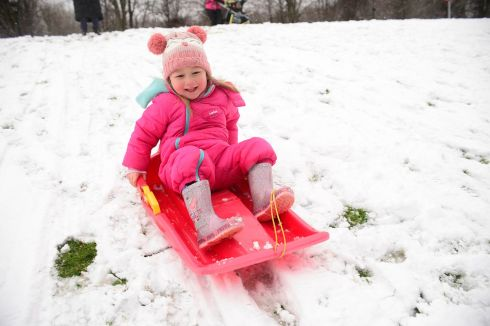 WINTER IN EARNEST: Ciara Lowry enjoys the snow at Stormont in Belfast. Heavy snow showers had led to disruption across parts of Northern Ireland, and dozens of schools were closed due to wintry conditions.  Photograph: Arthur Allison/Pacemaker