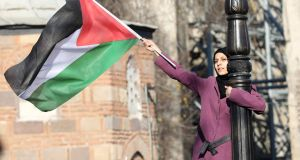 A pro-Palestinian protester holds a Palestinian flag in Ankara. Photograph: Altanadem Altan/AFP/Getty Images