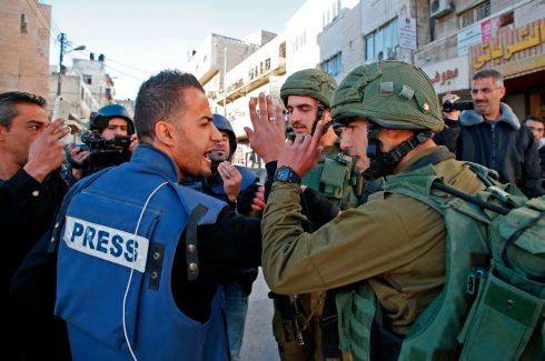 A journalist argues with a member of the Israeli forces during clashes in Hebron in the Israeli-occupied West Bank on December 9th, 2017, following the US president's controversial recognition of Jerusalem as Israel's capital. Photograph: Hazem Bader/AFP/Getty Images