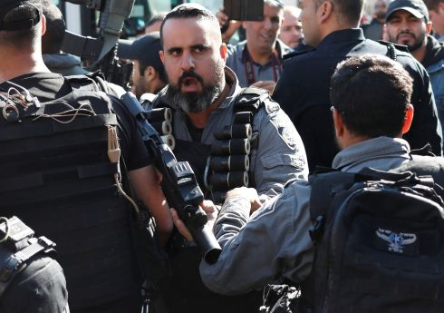 An Israeli border policeman holds his weapon in front of the Damascus Gate outside the Old City of Jerusalem. Photograph: Goran Tomasevic/Reuters