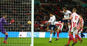Harry Kane leaps to score his first goal in Tottenham's win over Stoke. Photograph: Steve Bardens/Getty