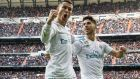 Real Madrid's Portuguese forward Cristiano Ronaldo  celebrates with his team-mate Marco Asensio after scoring against Sevilla during their Spanish Primera Division league game  at Santiago Bernabeu Stadium in Madrid. Photograph: Rodrigo Jimenez/EPA