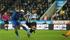 Ayoze Perez of Newcastle United scores an own goal under pressure from Shinji Okazaki of Leicester City during the Premier League match  at St James' Park. Photograph: Jan Kruger/Getty Images