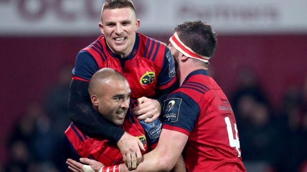 Munster's Simon Zebo celebrates scoring a try with Andrew Conway and Jean Kleyn. Photograph: Dan Sheridan/inpho