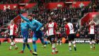 Olivier Giroud's late header snatched a point for Arsenal at St Mary's. Photograph: Catherine Ivill/Getty