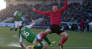 Celtic's Callum Mcgregor is tackled by Hibernian's Lewis Stevenson. Photograph: Andrew Milligan/PA
