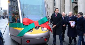 Straight down the line: the launch of the Luas Green line extension on O'Connell Street with Taoiseach Leo Varadkar,  Minister for Transport Shane Ross and Minister for Finance Paschal Donohoe. Photograph: Cyril Byrne
