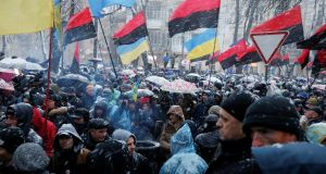 Supporters of former Georgian president Mikheil Saakashvili gather near a temporary detention facility where he is being held in custody in Kiev. Photograph: Gleb Garanich/Reuters