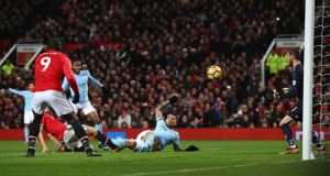 Nicolas Otamendi turns in Manchester City's winner at Old Trafford. Photograph: Michael Steele/Getty
