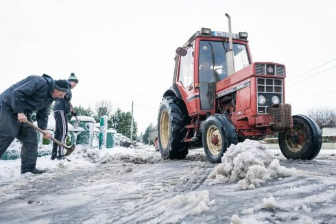 SNOW JOB: John Gayer, Conor McGuinness and Pat McGuinness clear snow from a road in Claremorris, Co Mayo. Photograph: Keith Heneghan