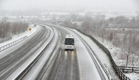 DRIVEN SNOW: A coach drives through the snow on the M7 motorway in Co Limerick. Photograph: Niall Carson/PA Wire