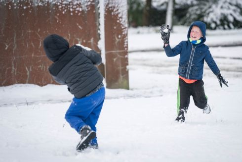 HAVING A BALL: Kipras Moskus (6) and Gustavs Ralfs Bhati (7) play in the snow in Grattan Park, Claremorris, Co Mayo. Photograph: Keith Heneghan