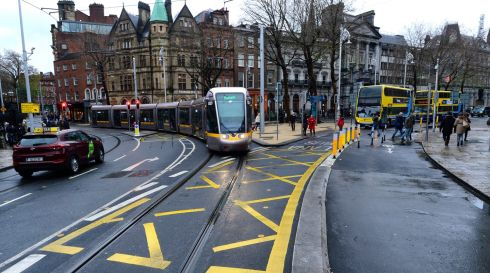LUAS CROSS CITY: A Luas tram at College Green, Dublin, following the opening of Luas Cross City. Photograph: Cyril Byrne/The Irish Times