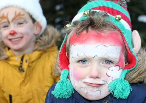 POLE POSITION: JJ Doyle (4) with his brother Christian Doyle (3) at the Santa Hat Challenge in Dún Laoghaire, Co Dublin, in aid of Enable Ireland. Photograph: Stephen Collins/Collins Photos