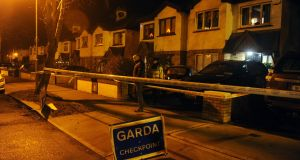 A garda outside a house on Woodville Avenue in Lucan, Co Dublin, on Sunday night, where the remains of a man were found on Sunday afternoon. Photograph: Aidan Crawley