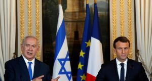 "Israeli prime minister Binyamin Netanyahu and French president Emmanuel Macron: ""France judges the recent statements by the US president as contrary to international law and dangerous for peace,"" said Mr Macron. Photograph: Philippe Wojazer"