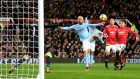 David Silva scores Manchester City's first goal at Old Trafford. Photograph: Michael Regan/Getty Images