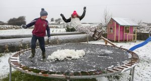Cousins Bertie Keane and Sophie Keane playing on a trampoline in the snow in the Rahoon area in Galway on Sunday. Photograph: Joe O'Shaughnessy  Cousins Bertie Keane and Sophie Keane playing on a trampoline in the snow in the Rahoon area in Galway on Sunday.  Photograph: Joe O'Shaughnessy. 10/12/2017