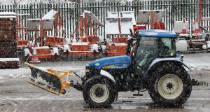 A tractor with a snow plough prepares to clear snow from the M7 motorway near Birdhill, Co Limerick. Photograph: PA