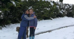 Cousins Tom Mannion and Ailbhe Hynes enjoy the snow in Moylough, Co Galway.  Photograph:  Joanie Mannion