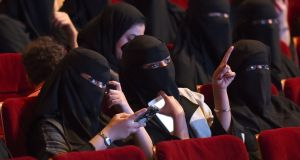 Saudi women at King Fahad culture centre in Riyadh. It was not immediately clear if cinemas would have family-only sections, segregating women and families from male-only audiences.  Photograph:  Fayez  Nureldine/AFP/Getty Images)