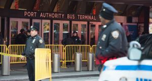 Police respond to a reported explosion at the Port Authority Bus Terminal  in New York. Photograph: Getty